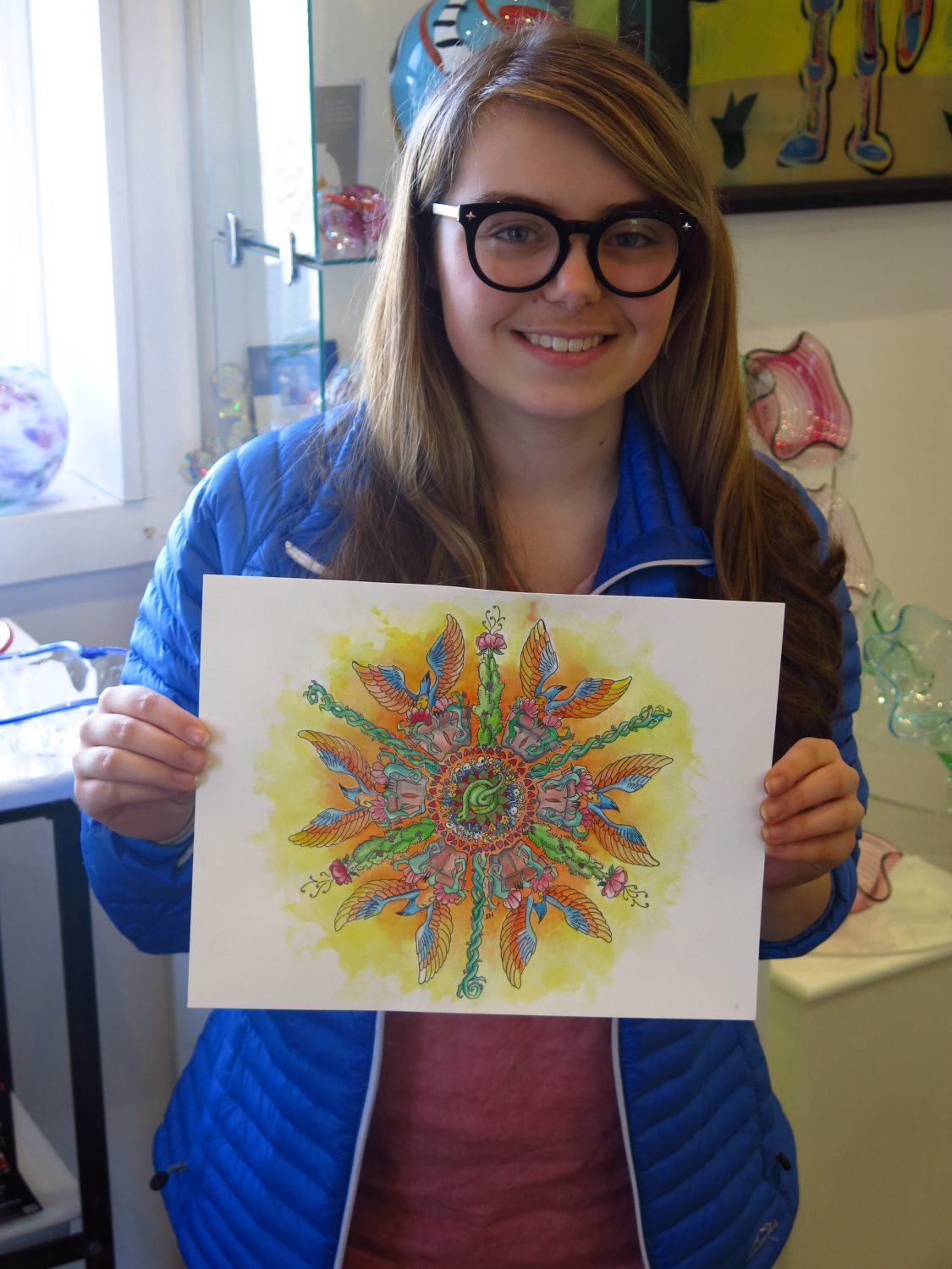 Emma poses with her finished mandala